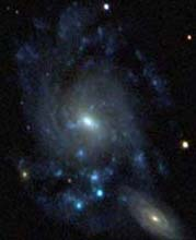 Two bright spiral galaxies seen by the SDSS